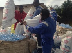 man sorting plastic bottles to be recycled